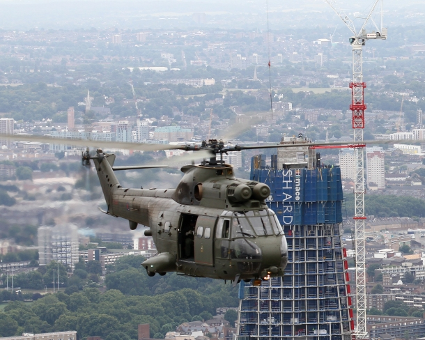 RAF Puma HC1 Helicopter Flies Past The Shard Skyscraper, London