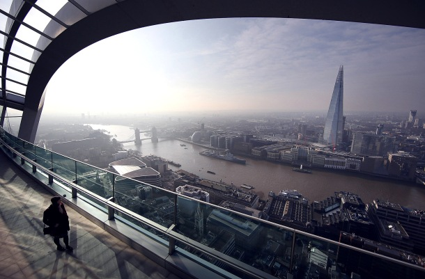 LONDON, ENGLAND - MARCH 12: A visitor looks at the view from the Sky Garden terrace at 20 Fenchurch Street on March 12, 2015 in London, England. Number 20 Fenchurch Street is London's newest skyscraper, known locally as The Walkie Talkie. The Sky Garden sits at the top of the 160 metre, 500 million GBP building and is now open to the public. (Photo by Peter Macdiarmid/Getty Images) ***BESTPIX***