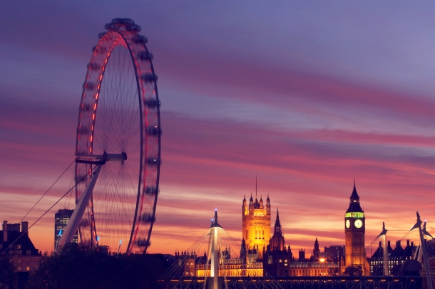 England, London, London Eye and Houses of Parliament, dusk